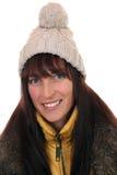 微笑的少妇画象在与盖帽的冬天 免版税库存图片