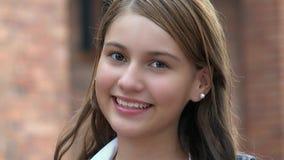 微笑的愉快女性青少年 图库摄影