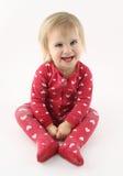 微笑的愉快的女婴 库存图片
