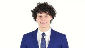 微笑的愉快的年轻商人,白色背景 股票视频