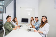 微笑的执行委员画象在会议室在会议期间 免版税库存照片