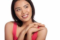 微笑的新亚裔女孩 免版税库存照片
