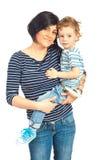 微笑的母亲和她的儿子 免版税图库摄影