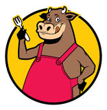 微笑的母牛佩带的围裙 免版税库存图片