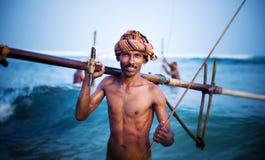 微笑的渔夫画象文化渔概念 免版税库存照片