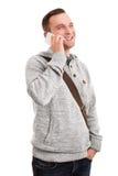微笑的男学生谈话在电话 图库摄影