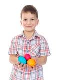 微笑的男孩用复活节彩蛋 库存照片