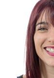 微笑的美丽的妇女的半面孔有红色头发的 免版税库存图片