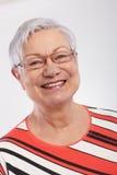 微笑的老妇人特写镜头纵向  免版税库存图片