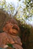 微笑的菩萨雕象 免版税库存图片