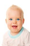 微笑的蓝眼睛的婴孩表面特写镜头。 免版税库存图片