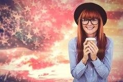微笑的行家妇女饮用的咖啡的综合图象 免版税库存照片