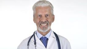 微笑的资深医生Isolated画象白色背景的 影视素材