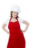 微笑的资深妇女厨师,被隔绝在白色 免版税图库摄影