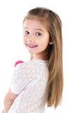 微笑的逗人喜爱的小女孩纵向查出 图库摄影