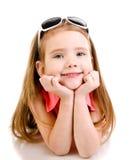 微笑的逗人喜爱的小女孩纵向查出 免版税库存图片