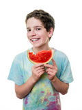 微笑的青少年的男孩用西瓜 库存图片