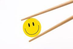 微笑的面孔筷子 免版税图库摄影