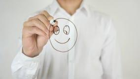 微笑的面孔,画在玻璃 库存图片