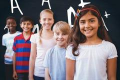 微笑的综合图象一点学校在学校走廊哄骗 库存照片