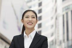 微笑的年轻女实业家画象,户外,北京,中国 免版税图库摄影