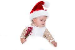 微笑的年轻婴孩照片圣诞老人帽子的 图库摄影