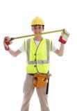 微笑的建造者或木匠 免版税库存照片