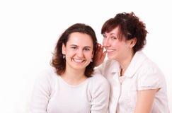 微笑美丽的女孩二个年轻人 库存图片