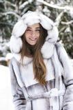 微笑美丽的接近的女孩的纵向  免版税库存照片