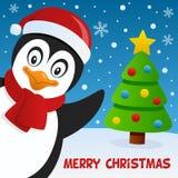 微笑逗人喜爱的企鹅和贺卡 免版税库存照片