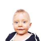 微笑逗人喜爱的男婴-七个月 免版税库存照片