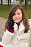 微笑青少年在白色外套 免版税库存图片