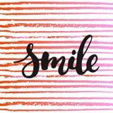 微笑-手拉的字法词组,隔绝在镶边背景 库存照片