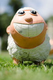 微笑绵羊被烘烤的黏土 库存照片