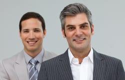 微笑co的行突出二名工作者 免版税库存照片