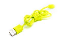 微USB充电器在白色背景的一个手机 图库摄影