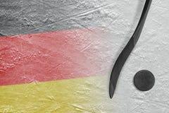 德国旗子和曲棍的图象有顽童的 免版税库存图片