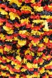 德国旗子的颜色作为五颜六色的背景的 库存图片