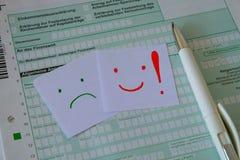 德国申报纳税和笔的一个空白表格 免版税库存图片