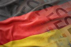 德国的五颜六色的挥动的国旗欧元金钱钞票背景的 免版税库存图片