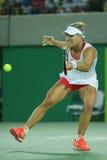 德国的奥林匹克亚军安赫利奎・克柏行动的在网球妇女的期间选拔决赛 免版税库存照片