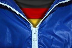 德国的旗子在被打开的拉链下的 库存图片