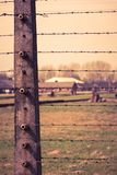 德国纳粹集中和灭绝阵营世界遗产奥斯威辛比克瑙,波兰的电有刺的导线 免版税库存图片