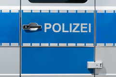 德国警车门的特写镜头与德国警察标签的 图库摄影