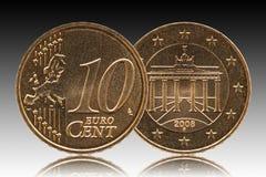 德国10欧分德国硬币、前方10和欧洲,后侧方勃兰登堡门 免版税库存图片