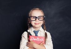 德语概念 逗人喜爱的儿童学生 免版税库存照片