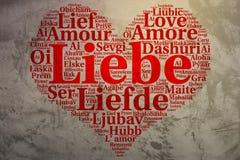 德语:Liebe 心形的词云彩爱,难看的东西背景 免版税图库摄影