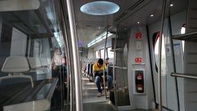 德里地铁教练内部-机场明确线 免版税图库摄影