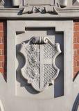 徽章在鸥的议院的前面的在里加 免版税库存图片