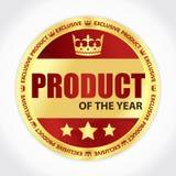 年徽章的产品与金黄丝带和红色背景的 库存照片